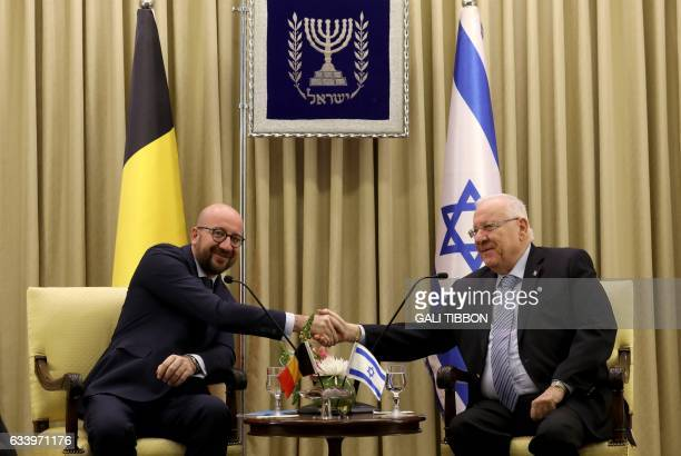 Israeli President President Reuven Rivlin shakes hands with Belgian Prime Minister Charles Michel during a meeting at the presidential compound in...