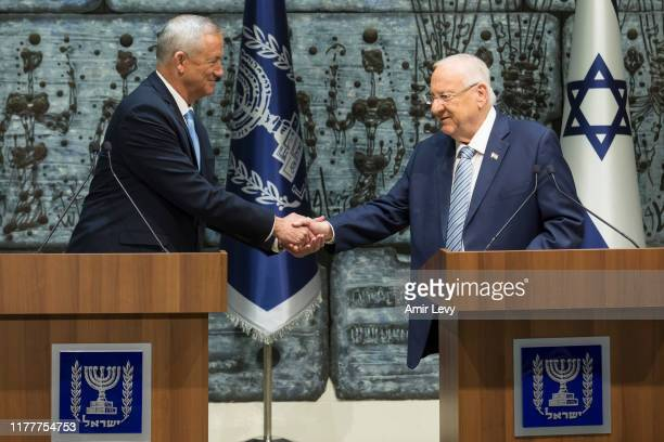 Israeli President Reuven Rivlin and Blue and White Party Leader Benny Gantz shake hands during a nomination ceremony on October 23, 2019 in...