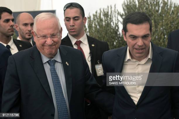 Israeli President Reuven Rivlin and Greek Prime Minister Alexis Tsipras arrive to a foundation stonelaying ceremony for a Holocaust museum in...