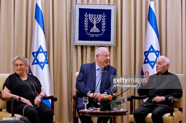 Israeli President Reuven Rivlin and his wife Nehama listen as FrenchArmenian singer Charles Aznavour speaks on October 26 2017 at the presidential...