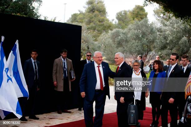Israeli President Reuven Rivlin and US Vice President Mike Pence speak during a formal reception ceremony at the presidential compound in Jerusalem...