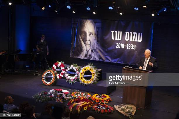 Israeli President Reuven Rivlin delivers a speech next to the coffin of Israeli author Amos Oz during a memorial service at the Tzavta Theater on...