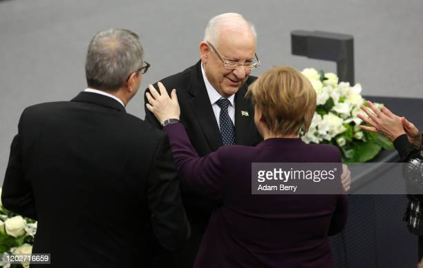 Israeli President Reuven Rivlin embraces German Chancellor Angela Merkel after speaking in the Reichstag during a session of Germany's lower house of...