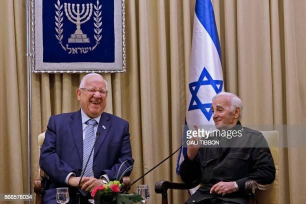 Israeli President Reuven Rivlin laughs as FrenchArmenian singer Charles Aznavour speaks on October 26 2017 at the presidential compound in Jerusalem...