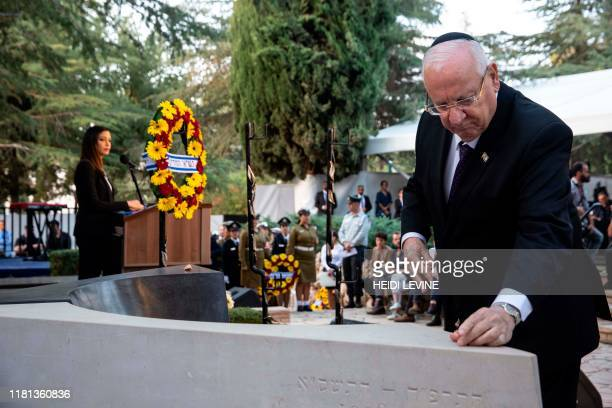 Israeli President Reuven Rivlin places a stone on the grave of former Israeli prime minister Yitzhak Rabin during a state memorial ceremony at Mount...