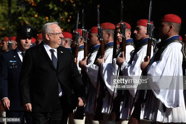 Israeli President Reuven Rivlin reviews the Greek Presidential Guard before a meeting with his Greek counterpart in Athens on January 29 2018 Rivlin...
