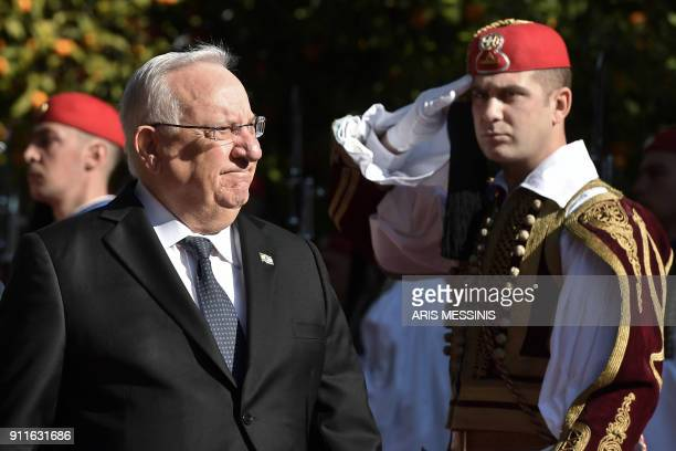 Israeli President Reuven Rivlin reviews the Greek Presidential Guard before his meeting with his Greek counterpart in Athens on January 29 as part of...