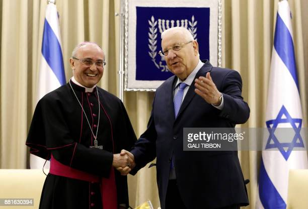 Israeli President Reuven Rivlin shakes hand with the newlyappointed Vatican Ambassador to Israel Papal Nuncio Archbishop Leopoldo Girelli after...