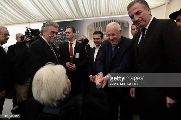 Israeli President Reuven Rivlin shakes hands with Holocaust survivor Zana SadikarioSaatsoglou as Greek Prime Minister Alexis Tsipras looks on during...