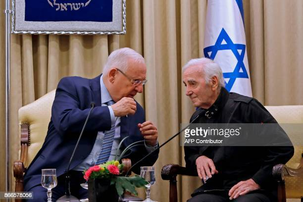 Israeli President Reuven Rivlin speaks with FrenchArmenian singer Charles Aznavour on October 26 2017 at the presidential compound in Jerusalem...
