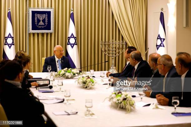 Israeli President Reuven Rivlin speaks with members of the Joint List Ayman Odeh , Ahmad Tibi , Mansour Abbas and Osama Saadi during a consulting...