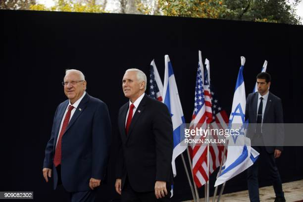 Israeli President Reuven Rivlin walks next to US Vice President Mike Pence during a formal reception ceremony at the presidential residence in...