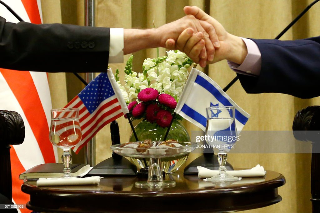 Israeli President Reuven Rivlin (R) welcomes US Defence Secretary James Mattis (L) in Jerusalem on April 21, 2017. /