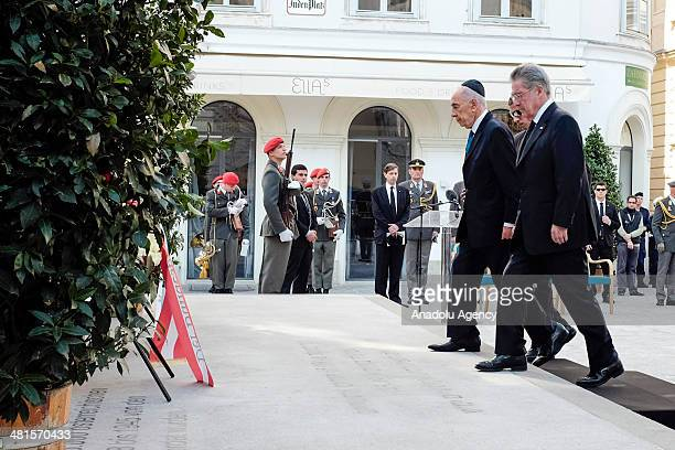 Israeli President Shimon Peres and President of Austria Heinz Fischer attend a wreath-laying ceremony at the memorial for Austrian victims of the...
