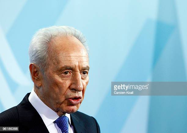 Israeli President Shimon Peres attends a press conference with German Chancellor Angela Merkel at the Chancellery on January 26 2010 in Berlin...