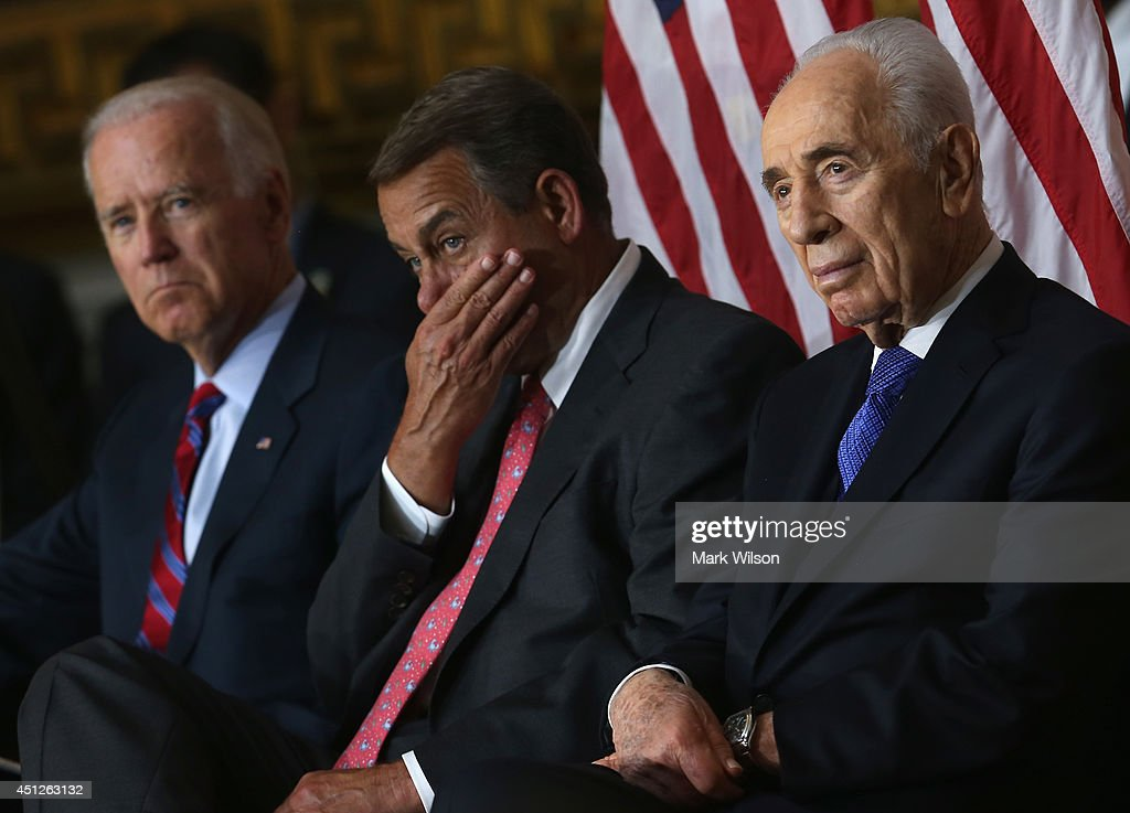 Israeli President Shimon Peres (R), House Speaker John Boehner (R-OH) (C), U.S. Vice President Joseph Biden (L) listen to speakers during a Congressional Gold Medal ceremony at the U.S. Capitol, June 26, 2014 in Washington, DC. President Peres was pressented with the Congressional Gold Medal which recognizes those who have performed an achievement that has an impact on American history and culture.