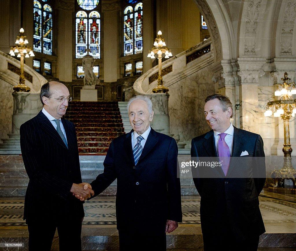 Maurits Hendriks Netherlands Prime Minister Mark Rutte L: Israeli President Shimon Peres Is Welcomed By Judge Peter