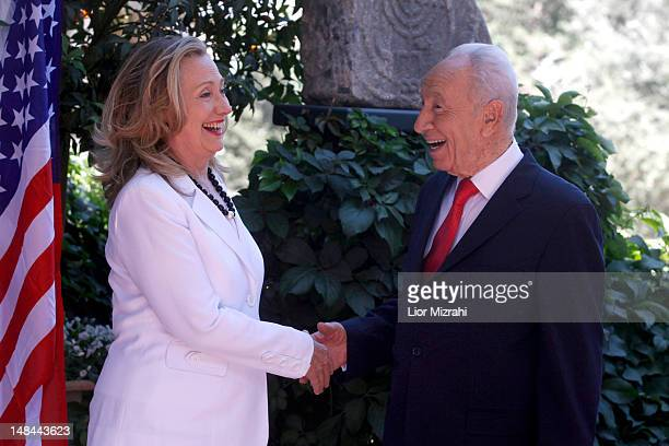 Israeli President Shimon Peres shakes hands with US Secretary of State Hillary Clinton before their meeting on July 16 2012 in Jerusalem Israel...