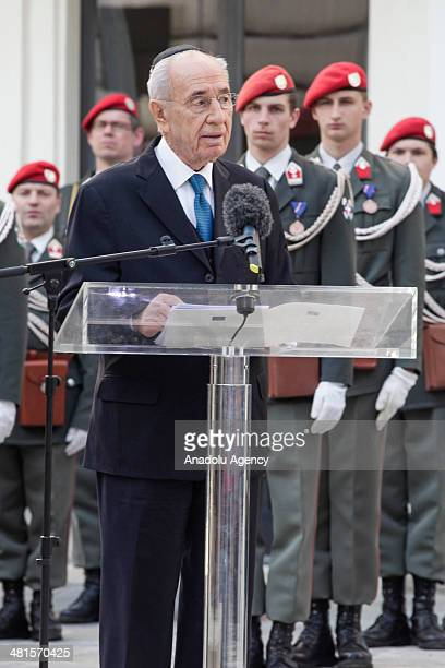 Israeli President Shimon Peres speaks after attending wreath-laying ceremony with President of Austria Heinz Fischer at the memorial for Austrian...