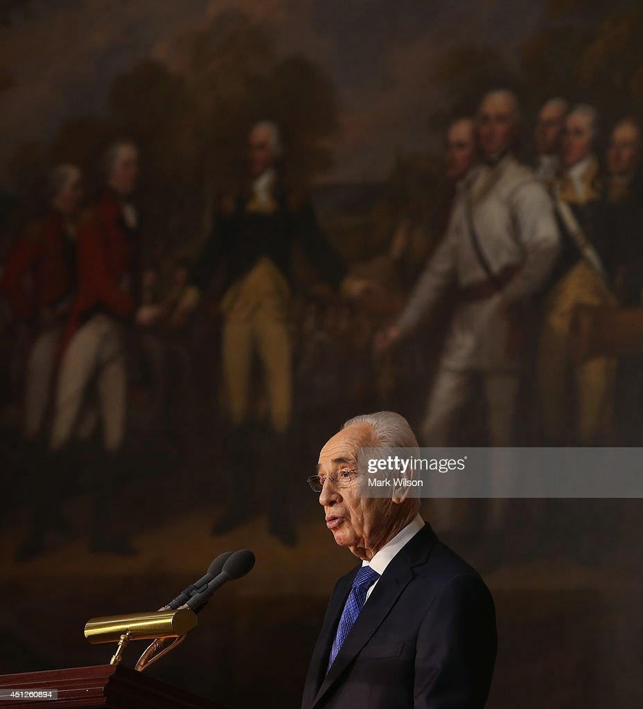 Israeli President Shimon Peres speaks after being presented with the Congressional Gold Medal during a ceremony at the U.S. Capitol, June 26, 2014 in Washington, DC. The Congressional Gold Medal recognizes those who have performed an achievement that has an impact on American history and culture.