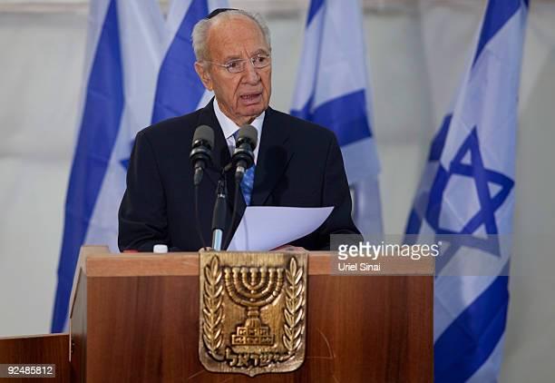 Israeli President Shimon Peres speaks during a memorial ceremony marking the 14th anniversary of the assassination of Israeli Prime Minister Yitzhak...