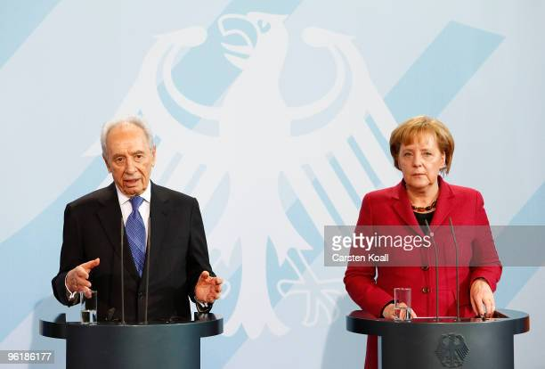 Israeli President Shimon Peres speaks during a press conference with German Chancellor Angela Merkel at the Chancellery on January 26 2010 in Berlin...