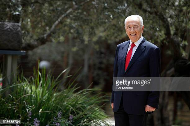Israeli President Shimon Peres speaks poses for a photo after an interview in the President house on April 10, 2013 in Jerusalem, Israel.
