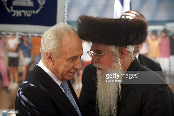 Israeli President Shimon Peres speaks to an Ultra Orthodox Jewish man during an open house in the President house on October 01, 2007 in Jerusalem,...