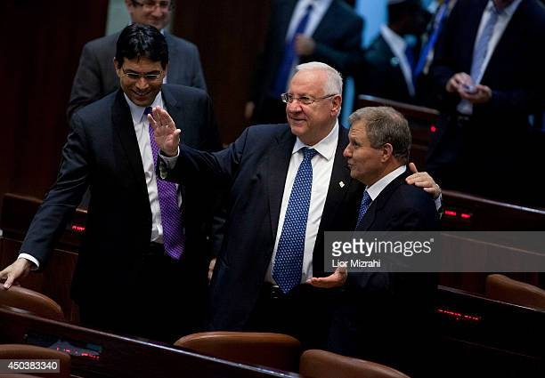 Israeli presidential candidates and former ministers Reuven Rivlin and Meir Sheetrit embrace each other during the second round of presidential...