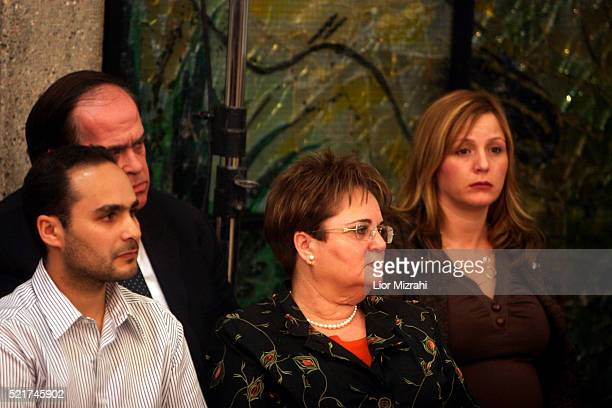 Israeli President's wife Gila looks on as her husband Moshe Katsav gestures as he speaks during a press conference at his residents in Jerusalem...