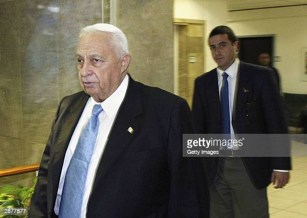 Israeli Prime Ariel Sharon arrives at the weekly cabinet meeting at his office on January 18 2004 in Jerusalem The cabinet was to commence...