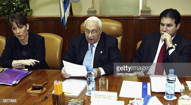 Israeli Prime Ariel Sharon conducts the weekly cabinet meeting at his office flanked by Education Minister Limor Livnat and Cabinet Secretary Yisrael...