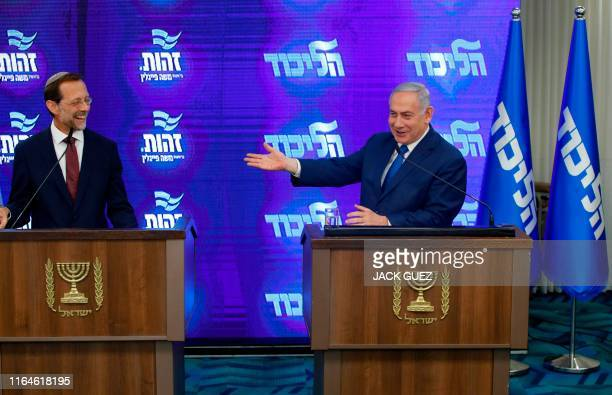 Israeli Prime Minister and Likud Chairman Benjamin Netanyahu and far-right Zehout political party chairman Moshe Feiglin give a joint press statement...
