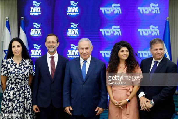 Israeli Prime Minister and Likud Chairman Benjamin Netanyahu poses for a picture with Zehout political party chairman Moshe Feiglin and others...