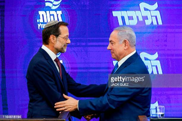 Israeli Prime Minister and Likud Chairman Benjamin Netanyahu shakes hands with with far-right Zehout political party chairman Moshe Feiglin during a...