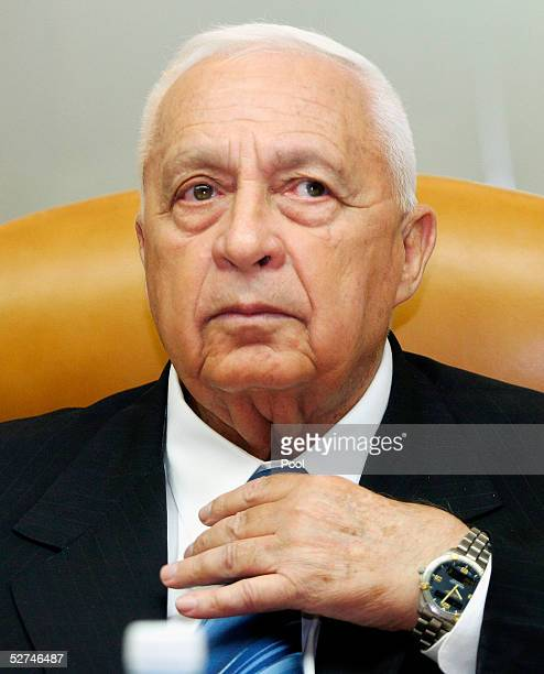 Israeli Prime Minister Ariel Sharon adjusts his neck tie as he chairs the government cabinet meeting on May 2 2005 in Jerusalem Israel Natan...
