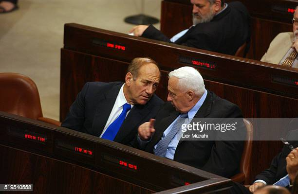 Israeli Prime Minister Ariel Sharon and Deputy Prime Minister Ehud Olmert speaks during a no-confidence motion against their government at the...