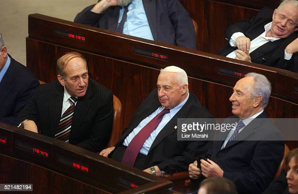 Israeli Prime Minister Ariel Sharon and Vice Premier Ehud Olmert and Vice Premier Shimon Peres seat during a Knesset, Israel's Parliament, session in...