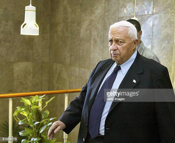 Israeli Prime Minister Ariel Sharon arrives for the weekly cabinet meeting on July 4 2004 in Jerusalem Israel Violence has surged in Gaza since...