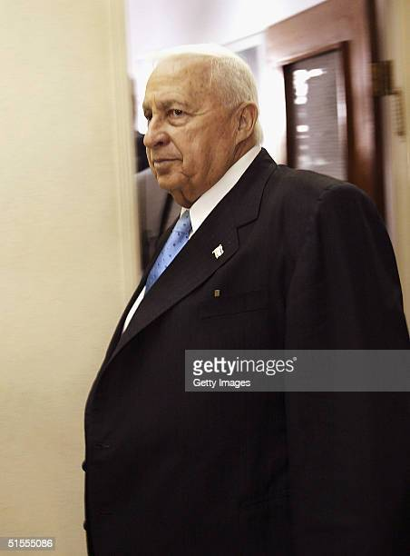 Israeli Prime Minister Ariel Sharon arrives for the weekly cabinet meeting in his Jerusalem offices on October 24 2004 in Jerusalem Israel The...