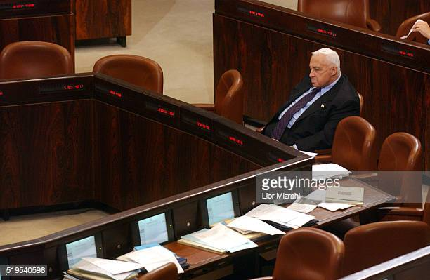 Israeli Prime Minister Ariel Sharon attends a non confidence vote in the Israeli Parliament Knesset in Jerusalem Monday June 7 2004 Sharon faced the...