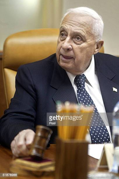 Israeli Prime Minister Ariel Sharon attends the weekly cabinet meeting at his office on December 19, 2004 in Jerusalem, Israel. Israel's Prime...