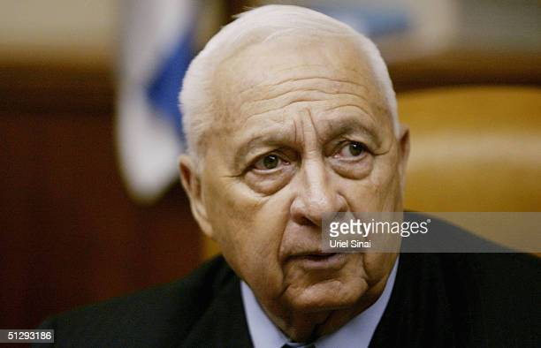 Israeli Prime Minister Ariel Sharon attends the weekly cabinet meeting on September 12 2004 in Jerusalem Israel Sharon said that Israel are...