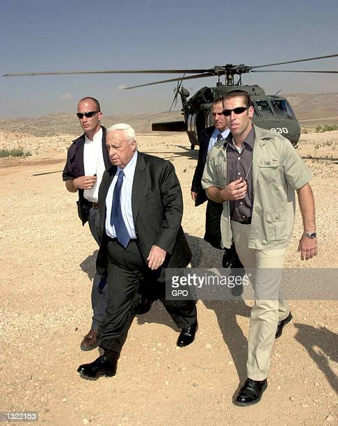 Israeli Prime Minister Ariel Sharon center arrives by military helicopter June 17 2001 under tight security at the West Bank Jewish settlement of...