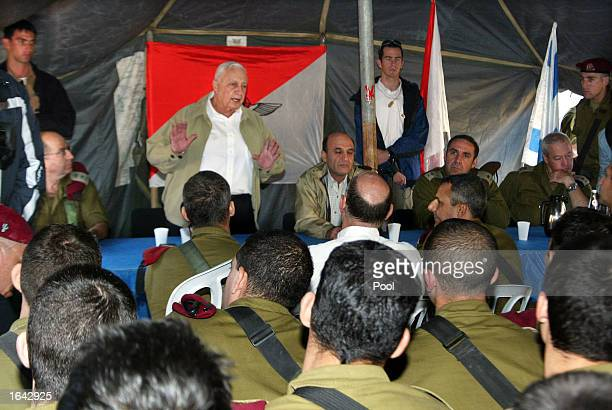Israeli Prime Minister Ariel Sharon gestures as he speaks to officers and soldiers as Defense Minister Shaul Mofaz and army Chief of Staff General...