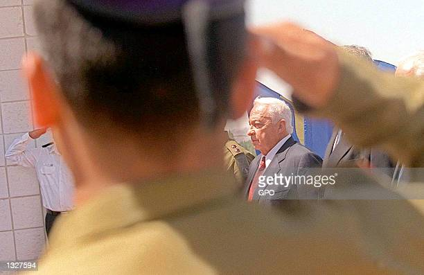 Israeli Prime Minister Ariel Sharon is framed by a soldier''s salute during a ceremony July 16 2001 at the prime ministry in Jerusalem