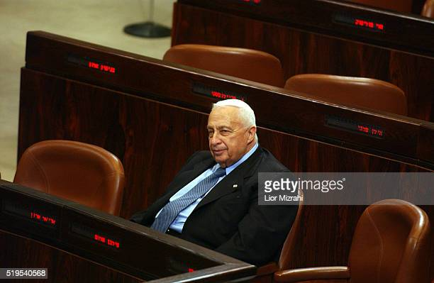 Israeli Prime Minister Ariel Sharon is seen at the Israel's parliament, during a no-confidence motion against the government in Jerusalem, Monday...