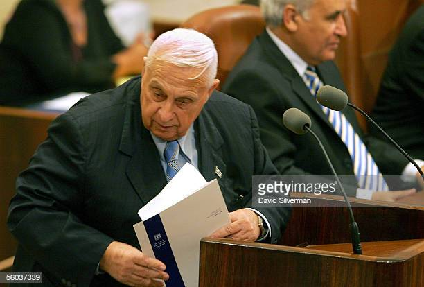 Israeli Prime Minister Ariel Sharon leaves the podium after reading his policy statement at the opening of the winter session of the Israeli...
