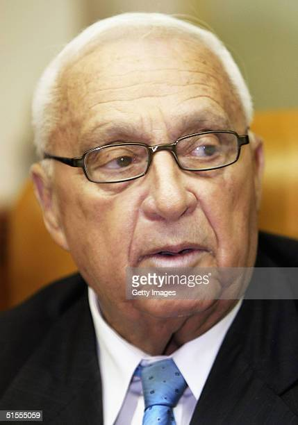 Israeli Prime Minister Ariel Sharon looks around to his ministers as he chairs the weekly cabinet meeting in his Jerusalem offices on October 24 2004...