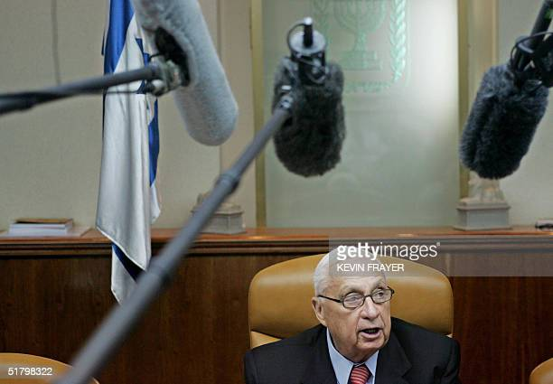 Israeli Prime Minister Ariel Sharon makes comments to reporters prior to the weekly cabinet meeting at the Prime Minister's office in Jerusalem, 28...